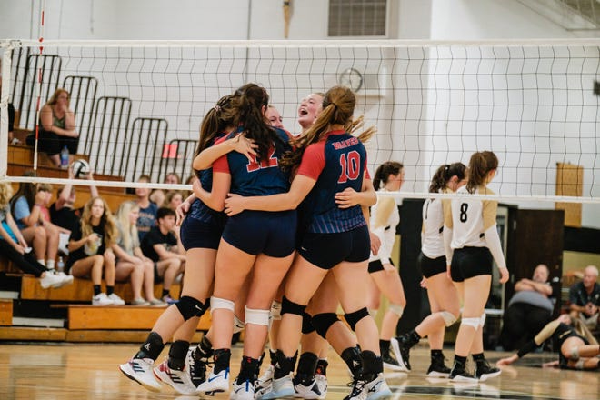 Indian Valley celebrates its win of the second set over Tuscarawas Central Catholic Tuesday, August 24.