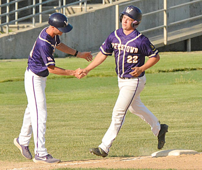 Watertown Post 17's Kale Stevenson (22) is congratulated by head coach Ryan Neale after smacking a home run against the Renner Royals this summer. Stevenson has been named to the Class A All-State Legion Baseball team, as selected by the state's coaches.