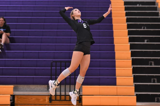 Wylie's Jaron McAden (6) goes up for a kill during Tuesday's match against Weatherford in a tri-match at Bulldog Gym.