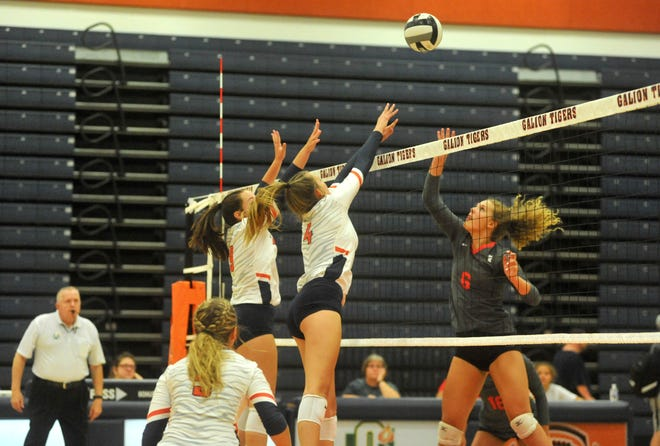 Galion's Madeline Schieber (9) and Hailey Young (4) try to block Bellevue's Caire Turner at the net.