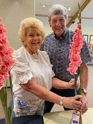 During the 2021 annual Northwest Ohio Gladiolus Society show at Lakeside, Doris and Cliff Hartline beam with pride as their seedling 16-80 collection of three spikes won the Ed Squires Award. The show, an international event, has been supports by Lakeside since the 1930s.