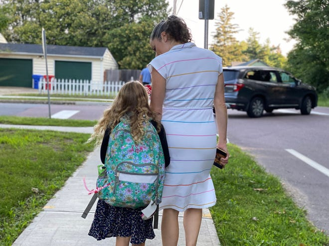 Trisha Shrum talks daughter Eleanor Shrum Myers, through her first day jitters as they walk to C.P. Smith Elementary School to begin Eleanor's second grade year, Aug. 25, 2021. Though masks will still be worn for the foreseeable future for Eleanor's age, the school will have less restrictions than the last year due to COVID.
