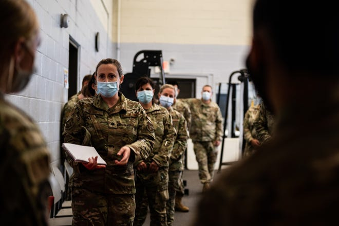 Airmen are briefed on the arrival of Afghans in support of the Department of State-led Operation Allies Refuge on Joint Base McGuire-Dix-Lakehurst on Aug. 22, 2021.