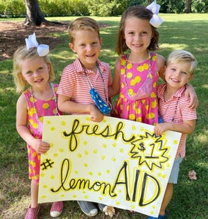 Poppy, Jack, Beatrice and Briggs are hosting a lemonade stand alongside their mothers, Amanda Zerbe and Hillary Weidner, to raise money for Cincinnati Children's Hospital Medical Center.
