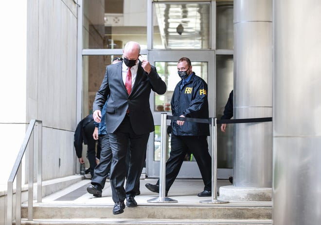 Tim Waters, special agent in charge for the FBI Detroit field office walks out of the Coleman A. Young Municipal Center after FBI agents conducted a search in the Detroit city council office in Detroit on August 25, 2021. The FBI also performed search warrants on the homes of Detroit council members Janee' Ayers and Scott Benson.