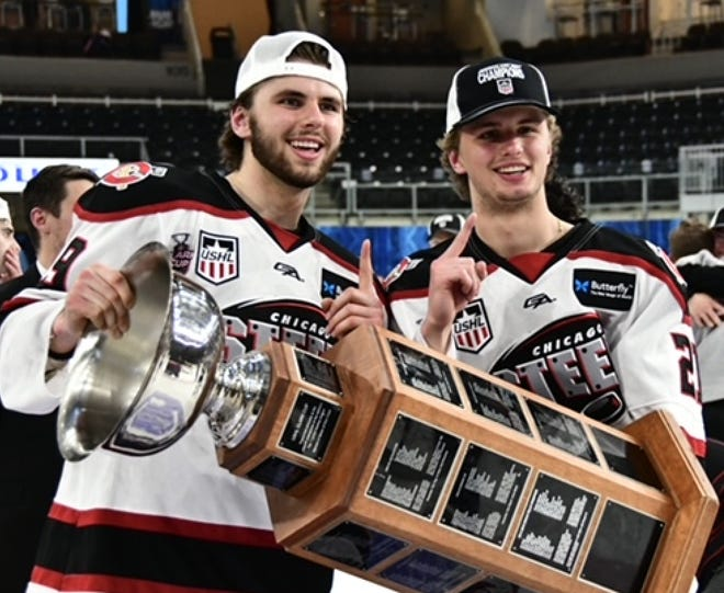 Adam Fantilli, left, and brother Luca Fantilli celebrate the Clark Cup championship with the Chicago Steel this year.