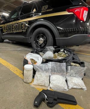 Fond du Lac County prosecutors charged two men Wednesday, Aug. 25, 2021, with felony drug possession and delivery after sheriff's deputies say they pulled them over Aug. 18 on Interstate 41. Police say they found more than 5 pounds of methamphetamine, 16 pounds of marijuana, along with crack cocaine and a loaded revolver in the vehicle.