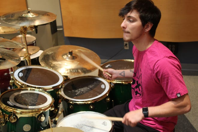 Jacob Amstutz, a member of the Terra Fusion Ensemble, rehearses with the band in June. The ensemble is scheduled to perform at Terra State Community College's Fall Rally Day Sept. 28.