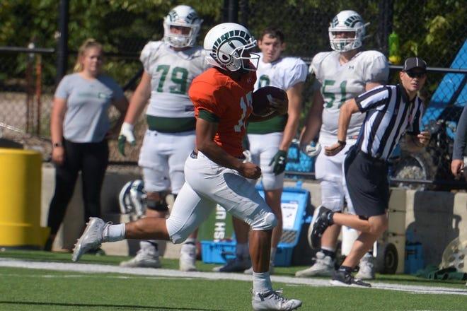 Colorado State quarterback Evan Olaes runs the ball during practice Tuesday, Aug. 24, 2021.