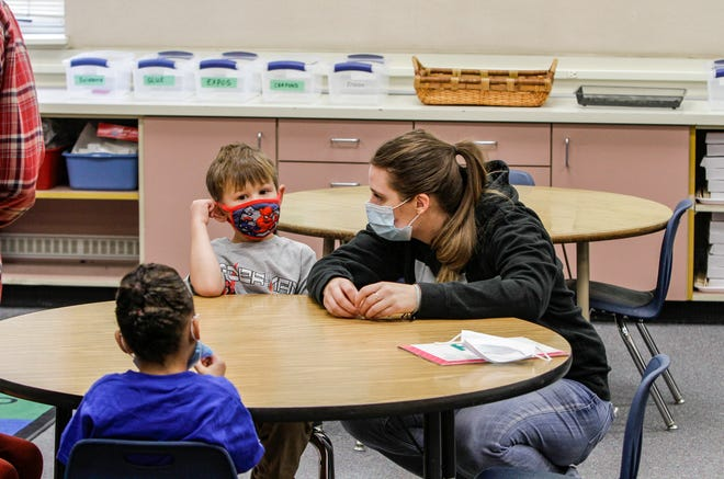 Kindergartner Kaden Tyler sits with his aunt, Brooklyn Gessup, on the first day of school at Whittier Elementary School on Wednesday morning.