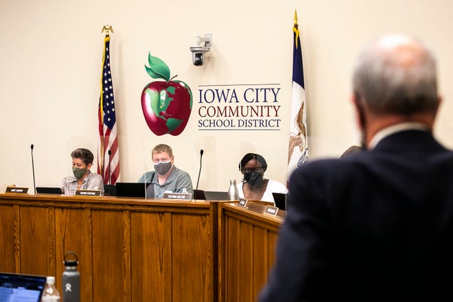 Iowa City Community School District board members, from left, Janet Godwin, Shawn Eyestone, president of the board, Ruthina Malone, vice president of the board, listen to Joe Holland, the Iowa City Community School District's attorney during a meeting, Tuesday, Aug. 24, 2021, at the district's Educational Services Center (ESC) at 1725 North Dodge Street in Iowa City, Iowa.