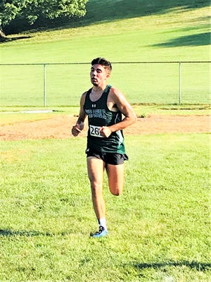 Fisher Catholic senior Patrick Kenney placed first to help lead the Irish to the Fisher Catholic Be More Invitational team title on Tuesday.
