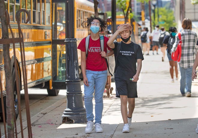 Students leave school early due to extreme heat at Golda Meir School on North King Drive in Milwaukee on Wednesday.