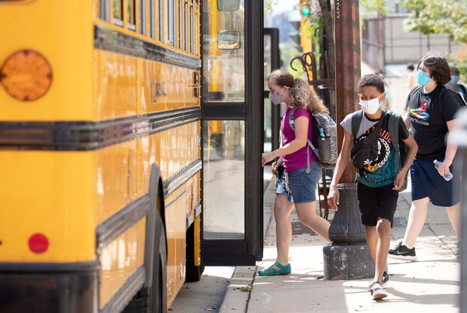 Golda Meir students board buses in August. The students on the school's lower campus transitioned to virtual learning Sept. 30 due to  COVID cases in the school population.