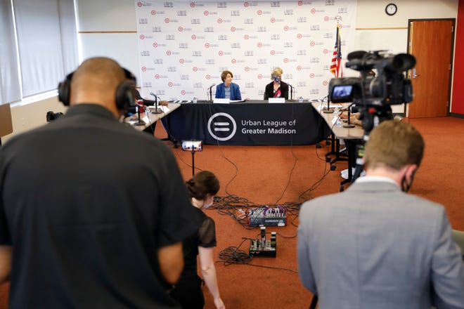 U.S. Senators Amy Klobuchar, left, and Tammy Baldwin, appear at a  voting rights roundtable at the Urban League in Madison.