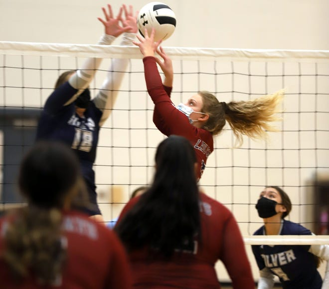 Senior Lady 'Cat setter Chloe Gomez-Gray (top-right) battled at the net with Silver High's Makaylah Roybal (18) on Tuesday. Gomez-Gray dished out 40 assists in a 3-1 volleyball victory over the visiting Fighting Colts.