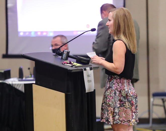 Tess Alvarez of Oshkosh speaks Tuesday during a city council meeting at the Oshkosh Convention Center. Alvarez was one of three people who spoke in favor of a proposed ordinance to reduce the fine for marijuana possession in the city.