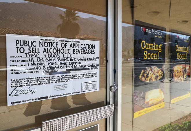 An application to sell alcoholic beverages is posted on the door future home of I Heart Mac & Cheese in downtown Palm Springs, August 25, 2021.