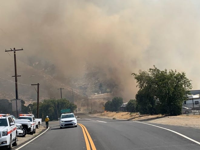Cal Fire is on scene of a brush fire that has closed a portion of Highway 243 in Banning on Wednesday afternoon, August 25, 2021.