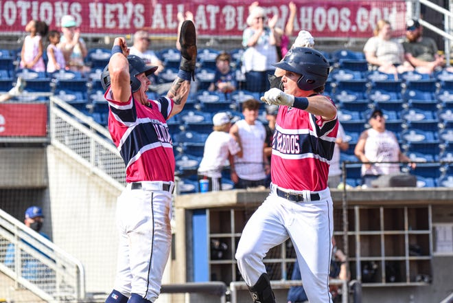 Griffin Conine celebrates with teammate Peyton Burdick Aug. 22 after his first-inning home run followed a surprise Blue Angels flyover during game against Biloxi at Blue Wahoos Stadium.
