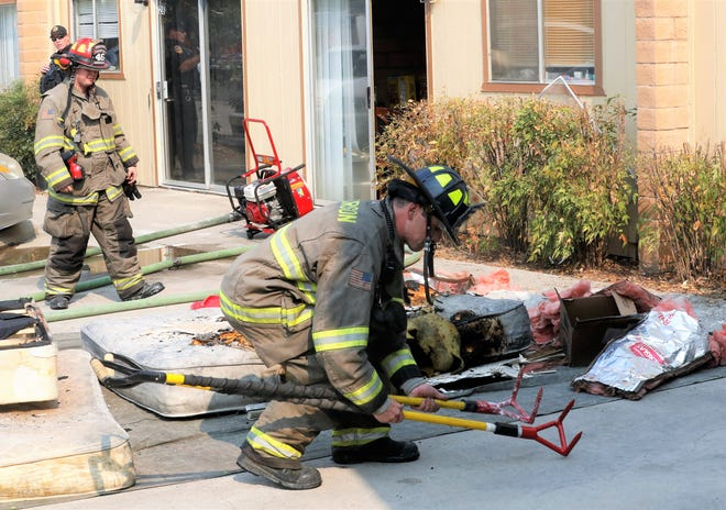 Firefighters gather their gear after putting out a mattress fire that started in the bedroom of an Anderson apartment complex Tuesday afternoon.