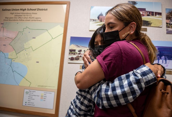 Gabriela Manzo, community advocate holds a Salinas student that emotionally broke down after they spoke to the board of trustees inside the Salinas Union High School District office in Salinas, Calif., on Tuesday, Aug. 24, 2021. The student spoke about the incident that happened last Friday night at the Jamboree in Salinas High School where students defaced a Black baby Doll.