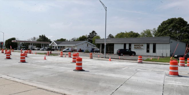 The exteriors of Kwik Trip and Menzer Glass, as seen, Wednesday, August 25, 2021, in Sheboygan, Wis. Kwik Trip has agreed to purchase the location in order to expand their Calumet Drive location.
