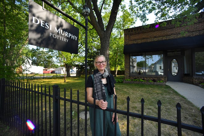 Desi Murphy stands in front of her new pottery studio Wednesday, Aug. 25, 2021, in St. Cloud.