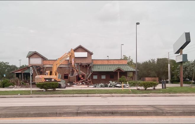The building at 5000 Okeechobee Road, which previously was occupied by restaurants Cowboys BBQ & Steak Co. and R.J. Gator's, was demolished Tuesday, Aug. 24, 2021.