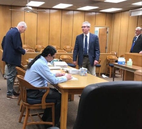 Defendant Micky Dawn Wade sits at a table in the 89th District Court during a break in his child sexual assault trial Wednesday, Aug. 25, 2021. From left of Wade to the right are Wichita County District Attorney John Gillespie, defense attorney Rick Mahler and officer Raymond Perry, an investigator for the state.