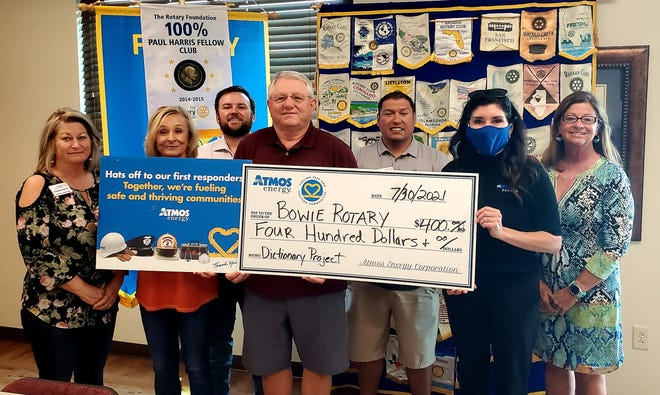 From left are: Rotary members Mayor Gaylynn Burris, Cindy Brewer, Brent Shaw, Randy West, Joe Delgado, Pam Hughes Pak with Atmos Energy, and Janis Crawley.