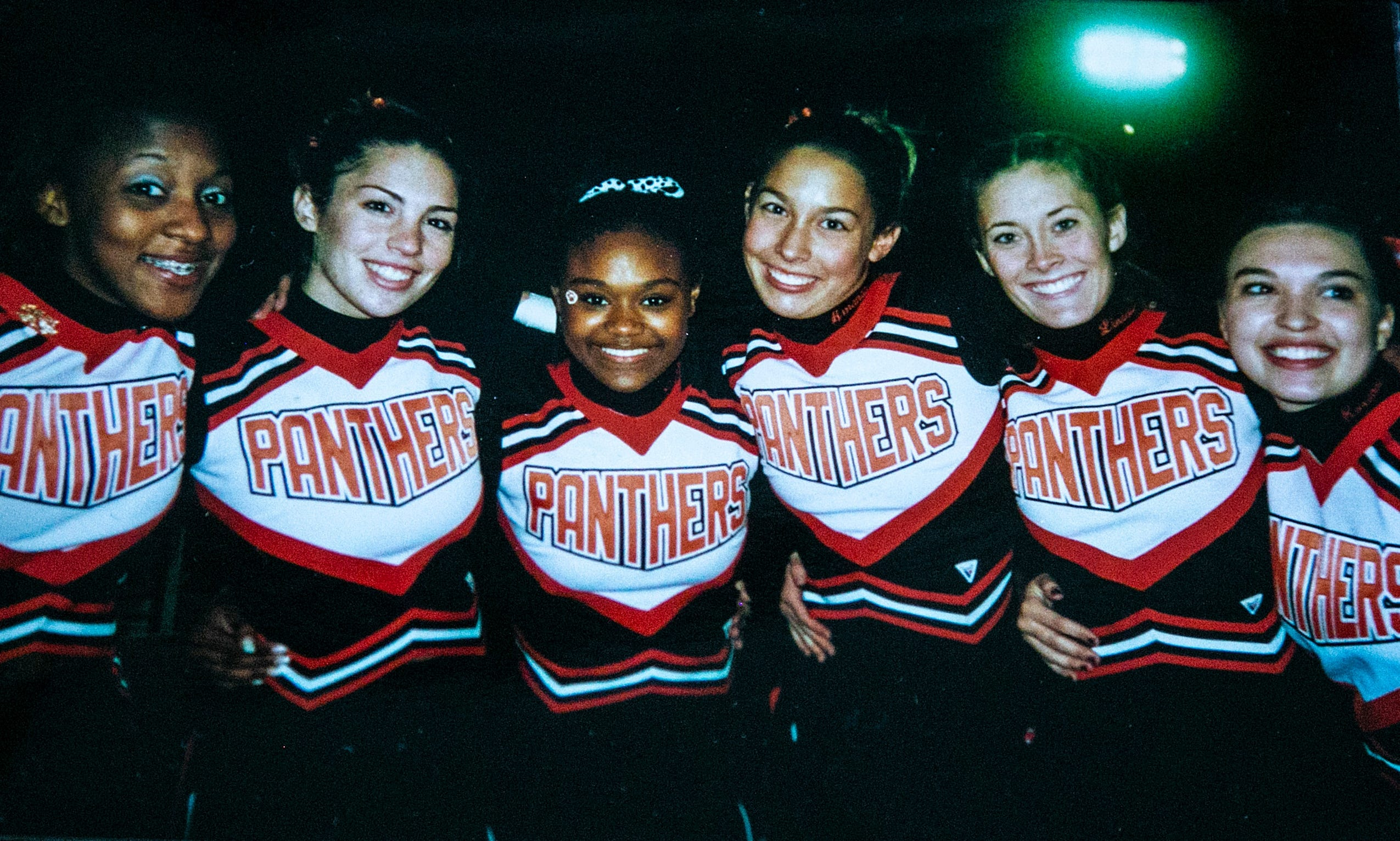United Township High School cheerleaders, including Amanda Adams, third from right, pose for a photo during the homecoming game in 2001.