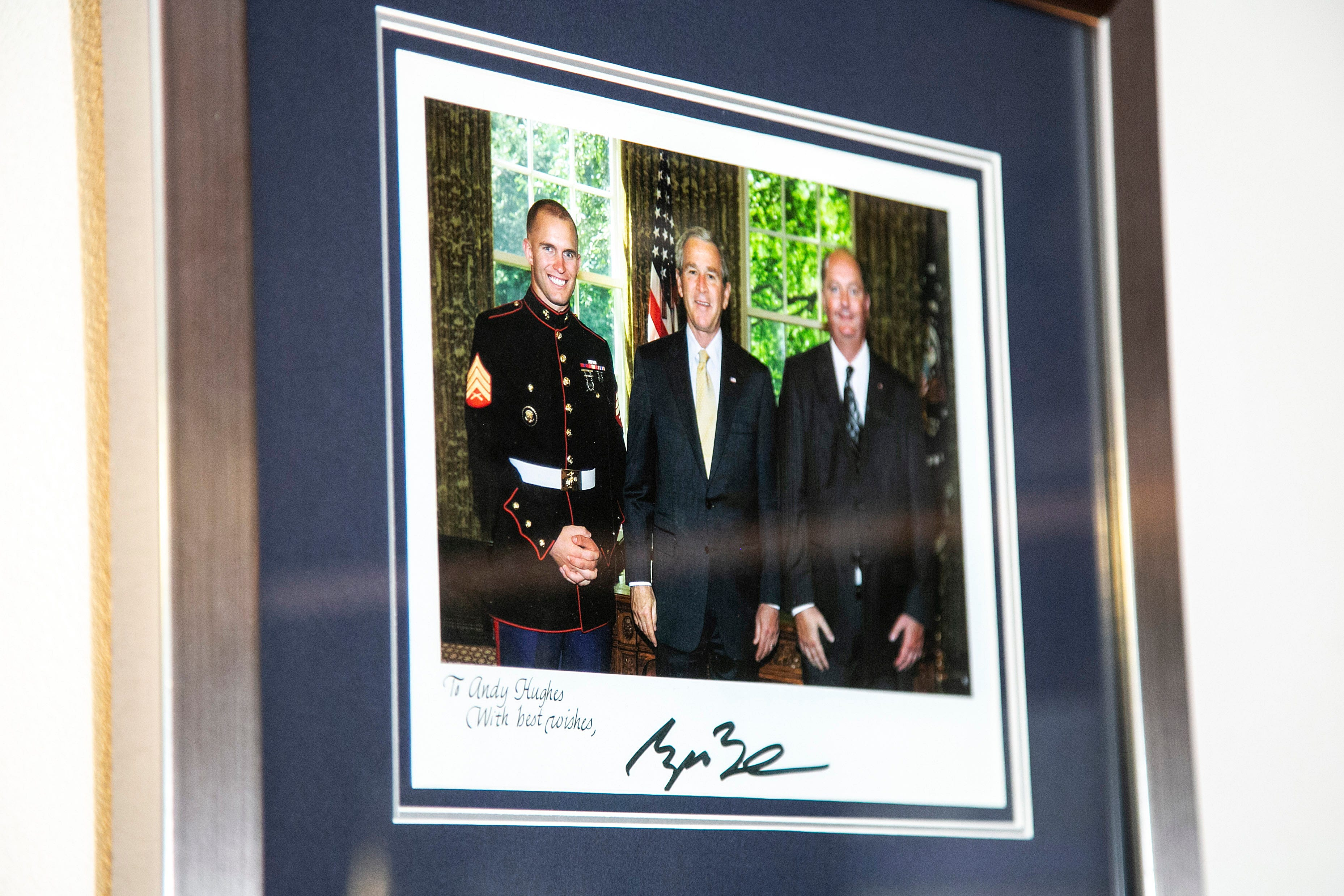 Andy Hughes, left, and his father met President George W. Bush.