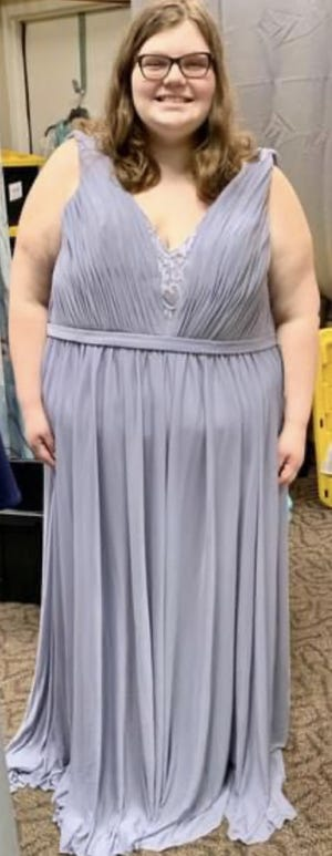Volunteer Maddie Marlowe models a dress. Rockin' Frocks in Northfield Center accepts donations of formal gowns, as well as takes donations to purchase gowns and accessories.