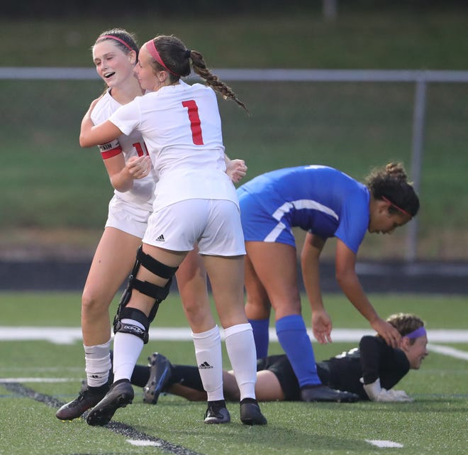 Manchester's Emma King celebrates a second half goal with Katie Norris against CVCA on Wednesday, August 25, 2021 in Cuyahoga Falls, Ohio.  [Phil Masturzo/ Beacon Journal]