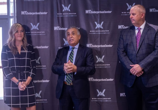 Dean of  Business at West Texas A&M, Amjad A. Abdulluat (center) addresses the press at the WT Enterprise Center along with WT Executive Director, Kyla Frye (left) and Amarillo Economic Development President Kevin Carter (right) Aug. 26, 2021.