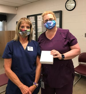 Ohio Hills Health Centers in Barnesville received 30 doses of the Pfizer Covid-19 vaccine from the Belmont County Health Department. Pictured, l to r, are Dorthea Blon-Reineke, LPN, OHHC and Christine Jenewein, RN, Belmont County Health Department.