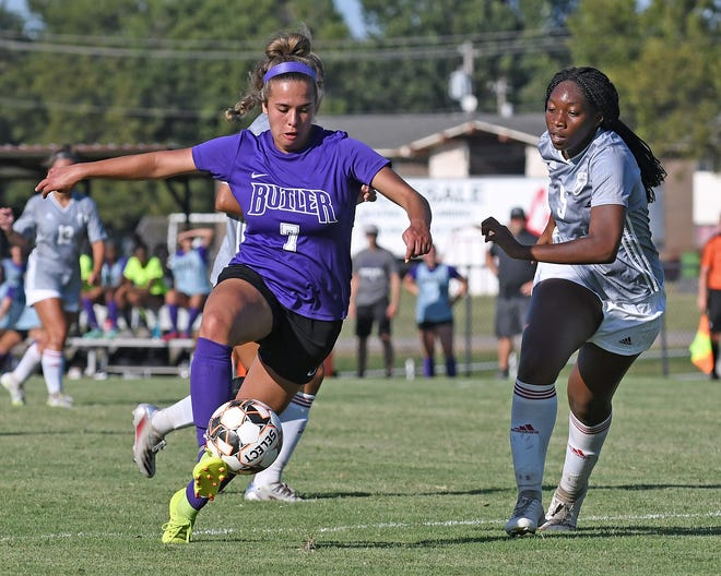 Butler sophomore midfielder Morgan Houston heads upfield while being defended by Northern Oklahoma-Tonkawa defender Amaka Etumudor during the Grizzlies' 3-2 loss at Tonkawa on Wednesday.