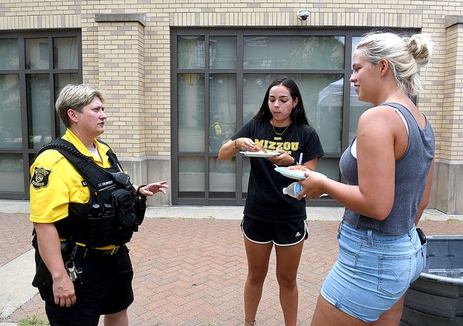 University of Missouri Police Lt. April Colbrecht, left, talks with MU freshmen Ciara Shelby, center, and Elizabeth Latson on Thursday during the Pizza with Police gathering near Hawthorne Hall. The annual event connects students with campus police officers at the beginning of the school year.