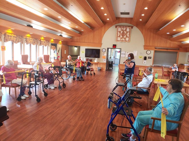 An exercise class using the sound system recently installed at Clinton Crest Manor courtesy of a Yates Community Endowment grant.