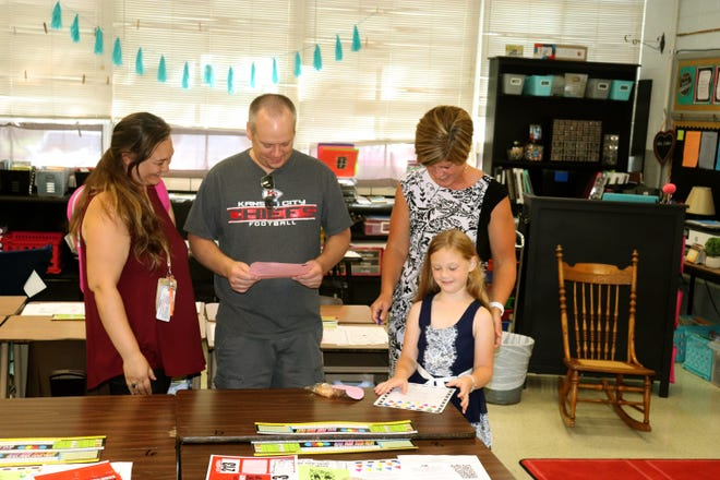 """A student and her family meet and chat with new Chillicothe R-2 Field Elementary School third grade instructor, during Tuesday's voluntary """"open house."""" Classes for Field students began the next day."""