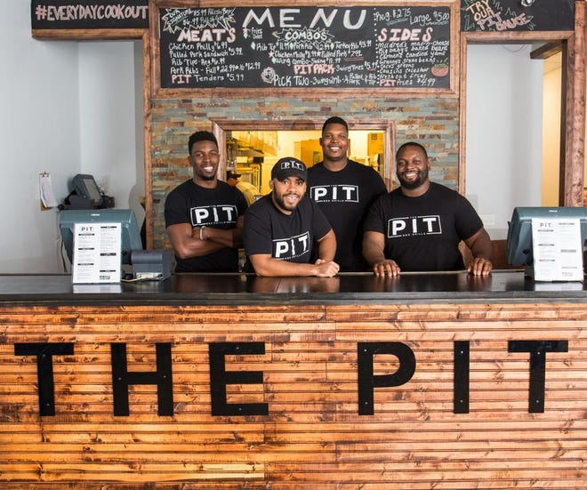 The owners of the Pit BBQ Grille, from left: Chimdi Chekwa, Mike Johnson, Bryant Browning and D'Andre Martin