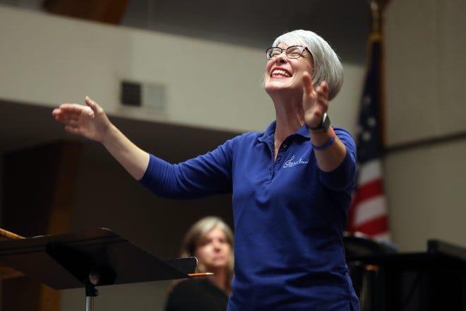 Kate Cremean, Gahanna Community Chorus director, leads the chorus in a song during a casual rehearsal session Aug. 16 at Mifflin Presbyterian Church in Gahanna.