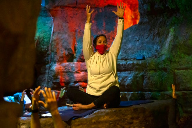 """Instructor Kelly Heiss leads a yoga session at Olentangy Indian Caverns in Delaware County. """"This is just one of those special, unique experiences,"""" she said."""