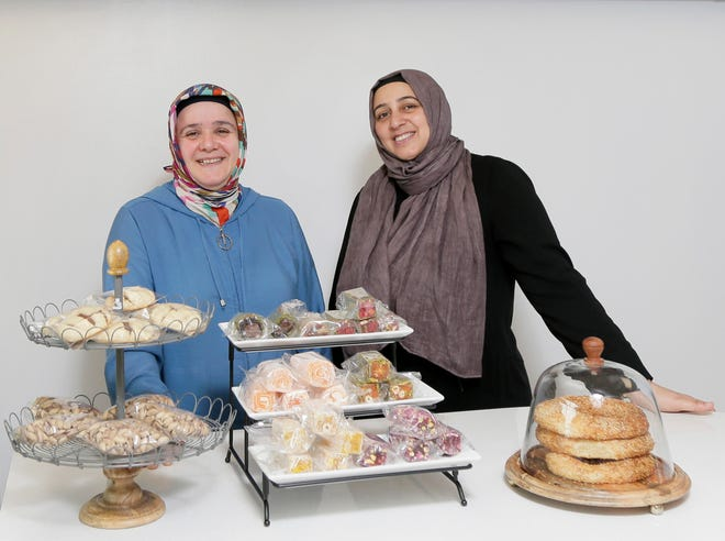 Friends Hanife Evliyaoglu, left, and Hatice Kucuker, right, have opened a storefront for Tulip Cafe, known from farmers market booths for their sweet and savory Turkish cuisine, at 2926 Hayden Run Plaza in north Columbus.