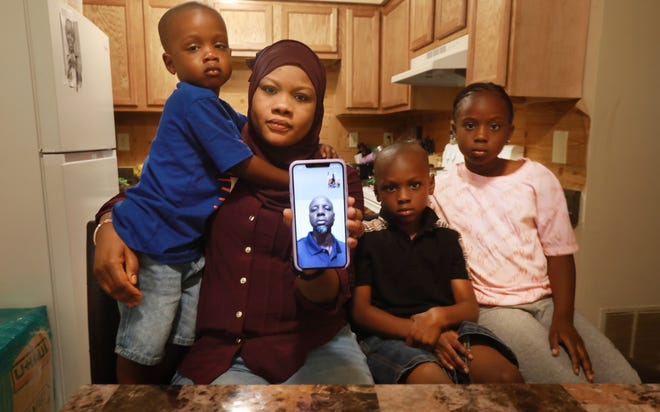 Surrounded by their three children, Vatimou Mikaill has a FaceTime conversation with her husband,, Abdoulaye Lam, from Mauritania, who was deported in 2018 and now lives in Senegal. The children are, from left, Mouhamed, 3; Abdoulahi, 7; and Aminatou, 8. Local groups are working with organizations across the nation to urge the Biden administration to bring back immigrants who were unfairly deported during the Trump administration.