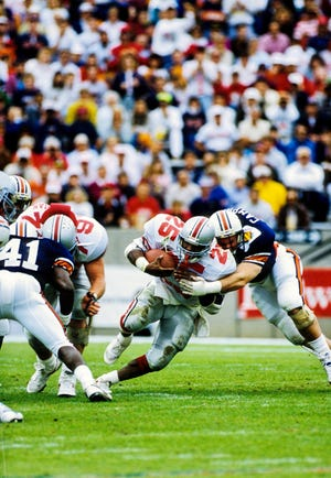 Carlos Snow (25) ranks 12th in school history in career rushing yards (2,999) and led the team in rushing in 1988, '89 and '91.