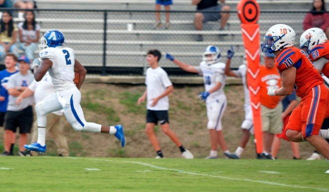 Asheboro's Michael Brady races 35 yards on a fake punt to set up the Blue Comets' first touchdown against Randleman last Friday. [Mike Duprez/Courier-Tribune]
