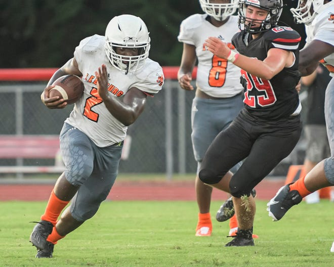 Leesburg's Eric Coffie (2) makes a carry during last weeks' preseason game in Bushnell. Leesburg hosts South Lake this week in its season opener, while South Sumter welcomes Crystal RIver. [PAUL RYAN / CORRESPONDENT]