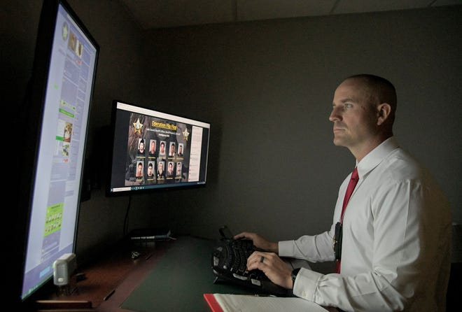 Lt. Cameron Crews talks about working to capture sexual predators with the Lake County Sheriff's Intelligence Unit while working on a computer at LCSO headquarters in Tavares on Monday, Aug. 23, 2021. [PAUL RYAN / CORRESPONDENT]
